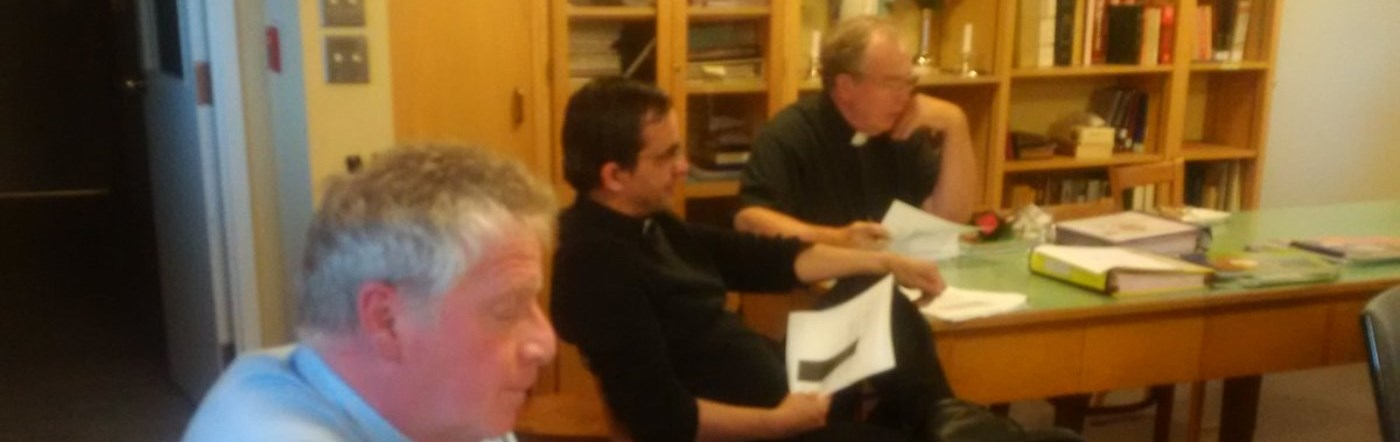 Priests sitting at a sacramental preparation session