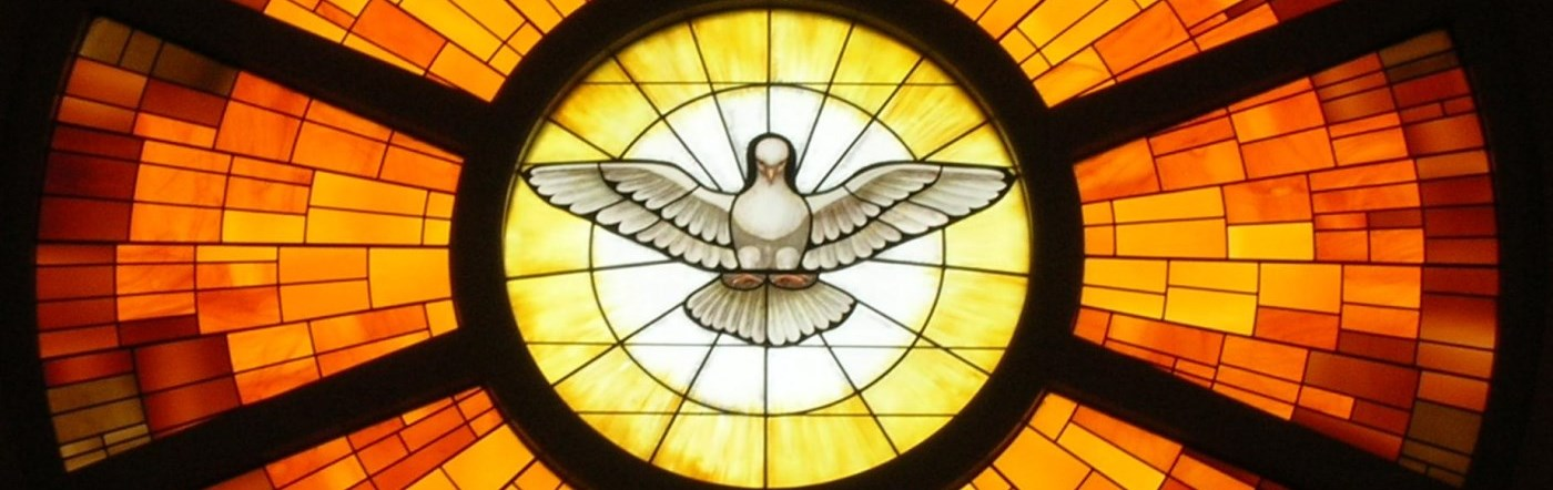 Stained glass window of the Holy Spirit in St. Peter's Basilica in Rome