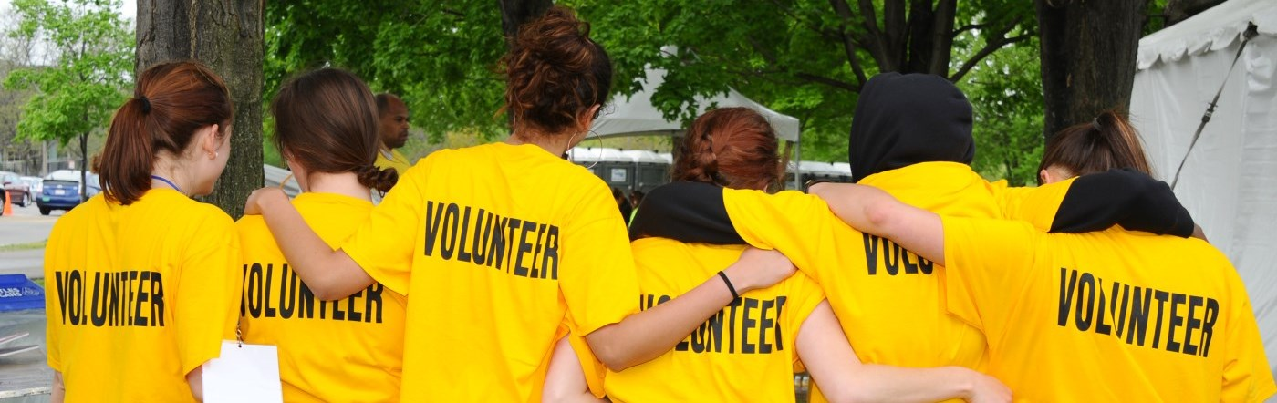 Group of volunteers with yellow t-shirts on